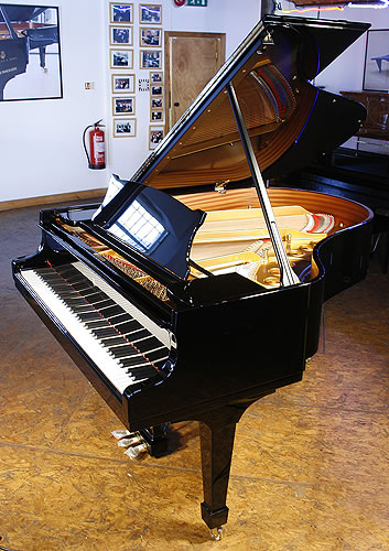 Brand New Steinway Model M Grand Piano For Sale with a black case. Price includes:  5 year warranty | First tuning free | Free matching, adjustable piano stool | Free delivery to a ground floor residence within mainland UK