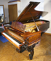 Steinway Concert Grand Piano For Sale with a carved, rosewood case